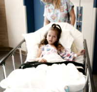 Image of a girl in a hospital bed